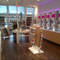 Photo taken at T-Mobile Corporate Store 1065 by Rene H. on 12/14/2012