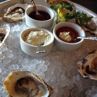Photo taken at High Tide Seafood Bar & Grill by David O. on 7/20/2014