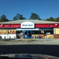 Photo taken at Mobil by John C. on 12/8/2013