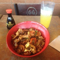 Photo taken at Genghis Grill by Aaron J. on 7/27/2015
