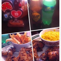 Photo taken at Nando's by Ivy T. on 2/8/2014