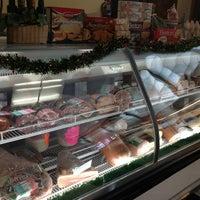 Photo taken at Neto's Market & Grill by Yoko R. on 12/22/2012