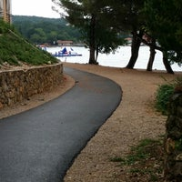 Photo taken at Njivice Promenade Running Track by Zsolt T. on 7/27/2014
