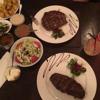 Photo taken at La Brasa Steakhouse by Наталья К. on 3/26/2016