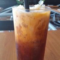 Photo taken at Moo Moo Thai Cafe by Joseph K. on 12/4/2014