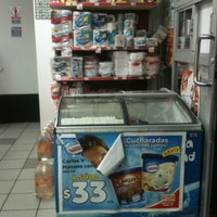 Photo taken at Oxxo Tepetlapa by Dave A. on 7/31/2013
