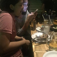 Photo taken at Tides Grill and Bistro by Zil E. on 1/8/2018