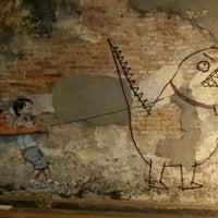 Photo taken at Penang Street Art : Little Boy with Pet Dinosaur by Bonn C. on 1/30/2016