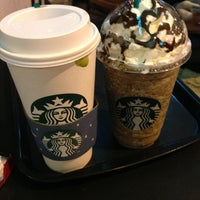 Photo taken at Starbucks by Xiang W. on 7/10/2013