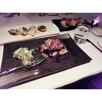 Photo taken at Zenzero Restaurant & Wine Bar by Kiwiz T. on 5/3/2014