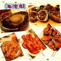 Photo taken at 黄沙水产交易市场 by Kanyasiri C. on 11/28/2012