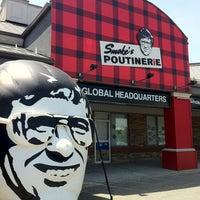 Photo taken at Smoke's Poutinerie by Matthew L. on 6/21/2013