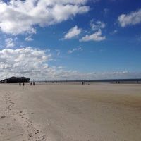 Photo taken at St. Peter-Ording Strand by Andreas O. on 9/26/2013