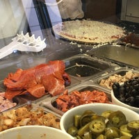 Photo taken at Pomodoro Pizza by Yoshie . on 9/8/2016