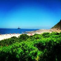Photo taken at Praia de Itacoatiara by André T. on 2/20/2013