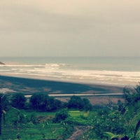 Photo taken at Rancabuaya Beach by Diki S. on 12/7/2013