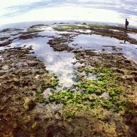 Photo taken at Rancabuaya Beach by Diki S. on 12/8/2013