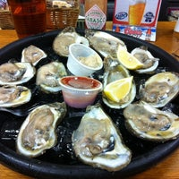 Photo taken at Dockside Seafood & Oyster Bar by Ken S. on 11/2/2013
