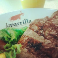 Photo taken at La Parrilla by Freitas N. on 9/28/2012