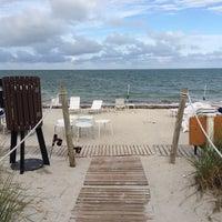 Photo taken at Ritz Carlton Key Biscayne white sand beach by Aman L. on 4/18/2014