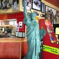 Photo taken at Red Robin Gourmet Burgers by Charlie V. on 2/3/2013