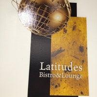 Photo taken at Latitudes Bistro & Lounge by Charlie V. on 11/21/2012