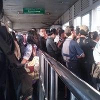 Photo taken at Halte TransJakarta PGC by Tara Ditha Y. on 10/21/2012