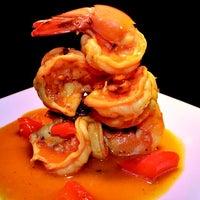 Photo taken at Moros Cuban Restaurant by Moros Cuban Restaurant on 8/12/2014