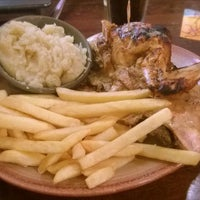 Photo taken at Nando's by Ben G. on 8/13/2014