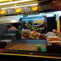 Photo taken at Abang & Adik Burger by Chee Y. on 11/7/2014