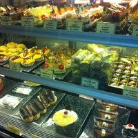 Photo taken at DE CAFÉ Resto & Delicatessen by Chelsea M. on 10/16/2012