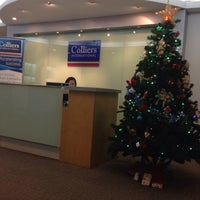 Photo taken at Colliers International Thailand by Mark B. on 1/9/2014