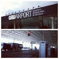 Photo taken at Terminal 1 (TPS1) by Elisa S. on 12/21/2012