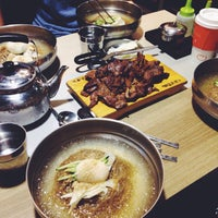 Photo taken at Yookssam Naengmyeon by Elena P. on 9/1/2015