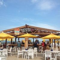Photo taken at Oak Street Beach Food + Drink by Jaclyn S. on 5/29/2013