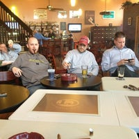 Photo taken at Outman Cigars & Martini Bar by Phil Y. on 3/14/2013