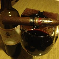 Photo taken at Outman Cigars & Martini Bar by Phil Y. on 3/2/2013