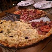 Foto tirada no(a) Molecaggio Pizzas por Vinicius H. em 10/12/2014