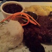 Photo taken at Zafra Cuban Restaurant & Rum Bar by Dexta H. on 3/8/2015