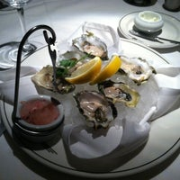 Photo taken at Truluck's Seafood, Steak and Crab House by Brittany Y. on 6/26/2012