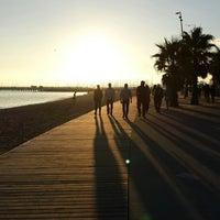 Photo taken at St Kilda Beach by Alper Barış S. on 6/29/2013