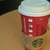 Photo taken at Starbucks by Ezio D. on 12/19/2012
