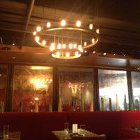 Photo taken at Shout! Restaurant & Lounge by Teela J. on 5/16/2013