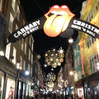 Photo taken at Carnaby Street by 狮 李. on 1/1/2013