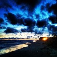 Photo taken at Praia de Ipitanga by Jean S. on 1/15/2013