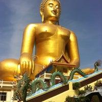 Photo taken at Wat Muang by Nat J. on 8/19/2012