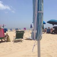 Photo taken at 76th Street Beach by Jason M. on 7/4/2013
