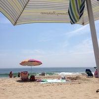 Photo taken at 76th Street Beach by Jason M. on 7/22/2013