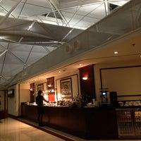 Photo taken at Emirates Lounge by Lak Y. on 1/29/2013