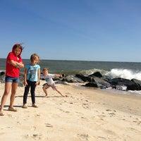 Photo taken at Gordon's Pond Beach by Kate S. on 8/14/2013